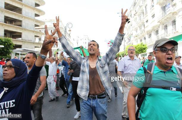 Algerian protesters shout antisystem slogans during the weekly Friday demonstration in the capital Algiers on June 21 2019 Hundreds of Algerian...