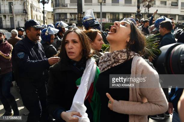 Algerian protesters shout slogans as they demonstrate in the capital Algiers against their president's bid for a fifth term on February 24 2019...