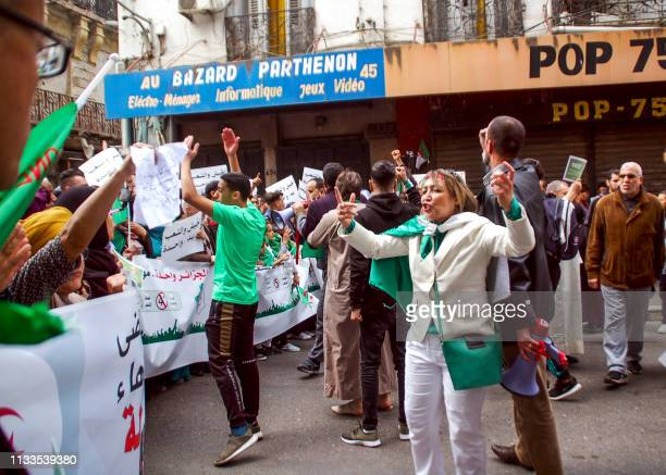 Algerian protesters shout slogans during a demonstration against ailing President Abdelaziz Bouteflika in the northern coastal city of Oran on March...