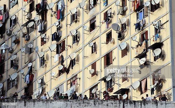 Algerian protesters stand by in front of their homes during clashes at Diar Eshams suburb on October 20 2009 in Algiers Protesters threw stones and...