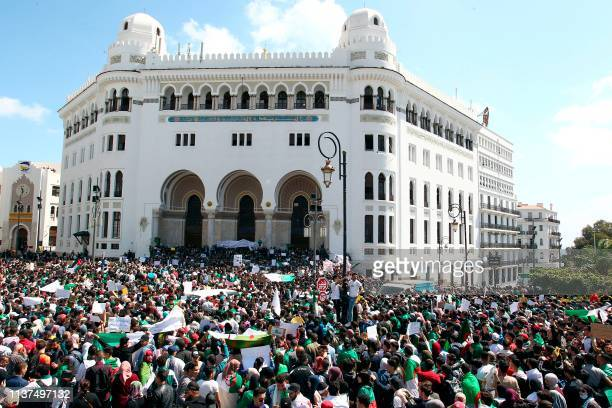 Algerian protesters take part in an antigovernment demonstration in front of La Grande Poste in the centre of the capital Algiers on April 16 2019...