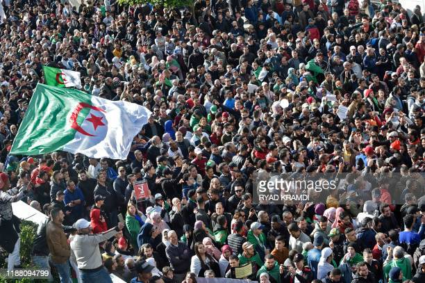 TOPSHOT Algerian protesters take part in an antigovernment demonstration in the capital Algiers on December 12 2019 during the presidential election...