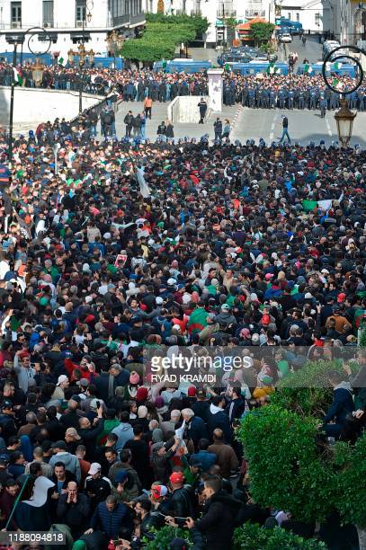 Algerian protesters take part in an antigovernment demonstration in the capital Algiers on December 12 2019 during the presidential election Five...