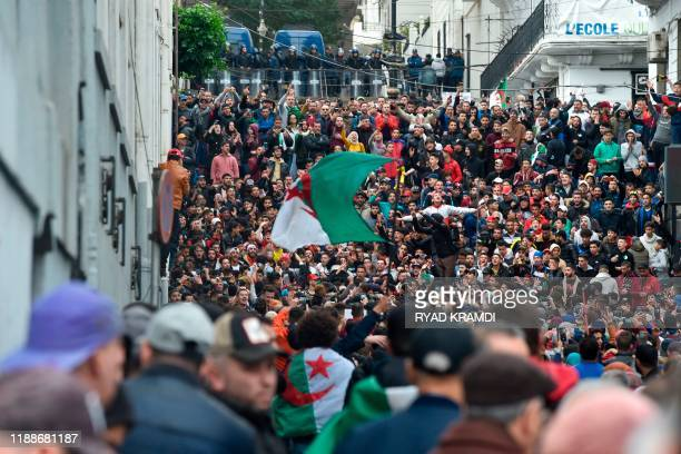 TOPSHOT Algerian protesters take part in an antigovernment demonstration in the capital Algiers on December 13 2019 during the presidential election...