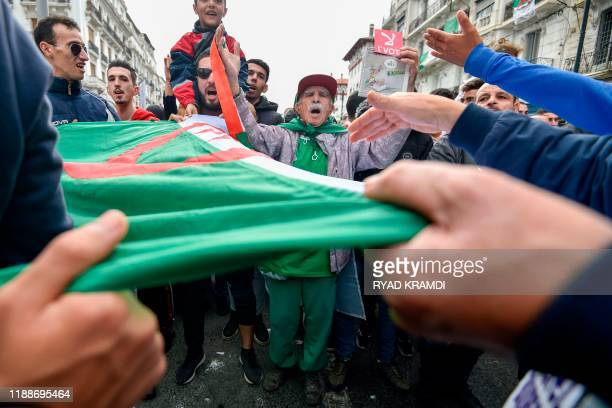 Algerian protesters take part in an antigovernment demonstration in the capital Algiers on December 13 2019 during the presidential election A former...