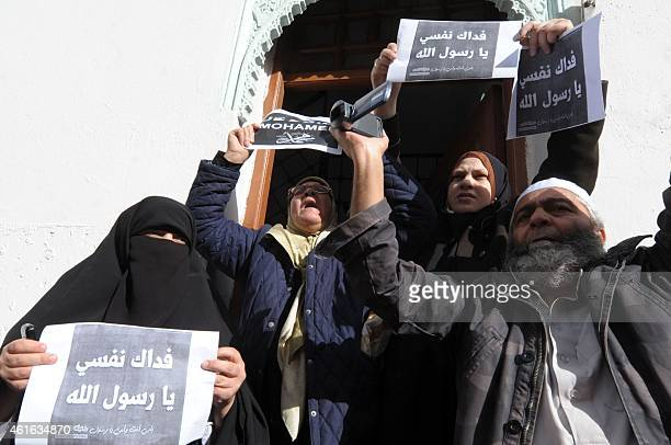 Algerian protestors hold up placards during a demonstration against French satirical weekly Charlie Hebdo for publishing a cartoon of the Muslim...