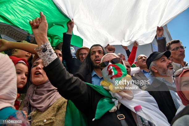 Algerian protestors shout slogans during a demonstration marking May Day in Algiers on May 1 2019