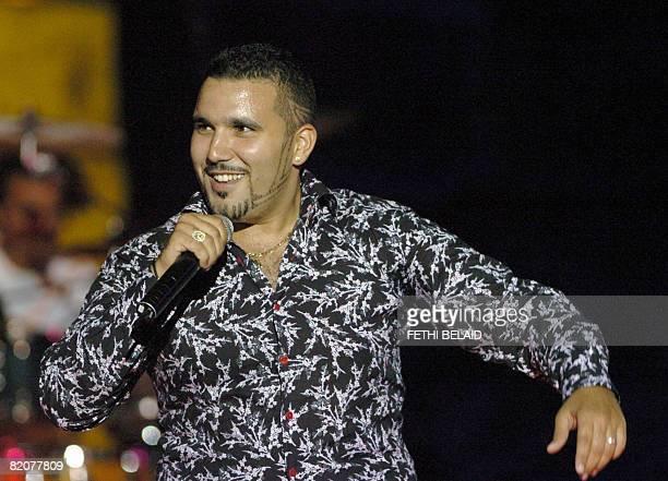 Algerian Rai singer Chab Ridha Talyani performs during the 44th International Carthage festival on 26 July 2008 at the Roman theatre in Carthage near...