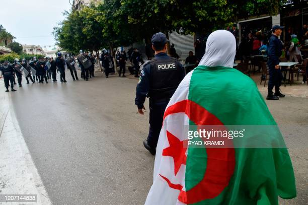 Algerian riot police gather during an anti-government demonstration in the capital Algiers on March 14, 2020.