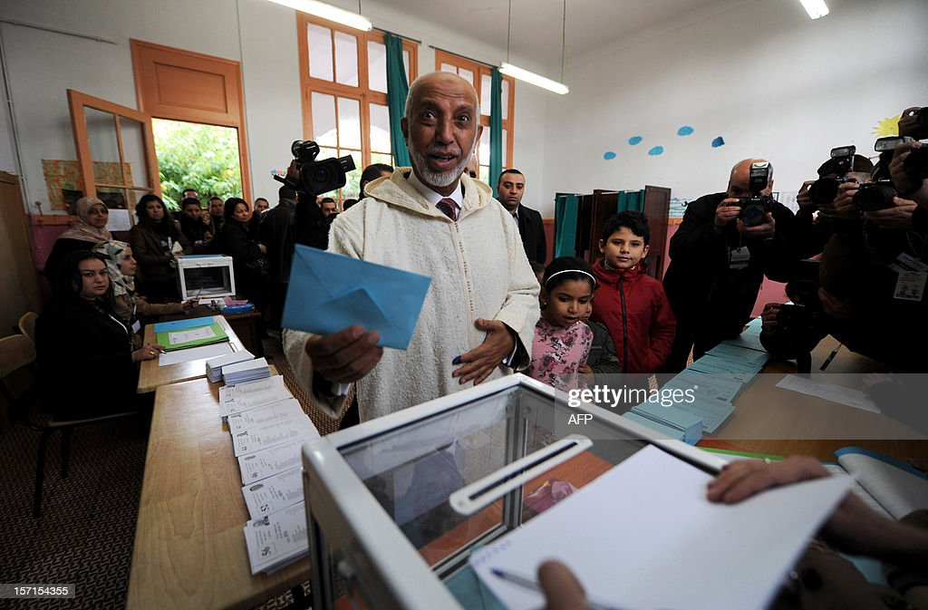 Algerian secretary general of the National Liberation Front (FLN) Abdelaziz Belkhadem, casts his vote at a polling station, set up at the El-Ghazali school in Algiers, during local elections on November 29, 2012. Algeria's ruling party is eyeing a landslide victory in local elections, with numerous opposition groups warning of fraud in a poll that could struggle to mobilise a disaffected electorate.