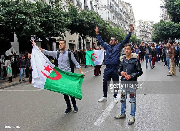 Algerian security forces contain protesters during an antigovernment demonstration in the capital Algiers on December 12 2019 during the presidential...