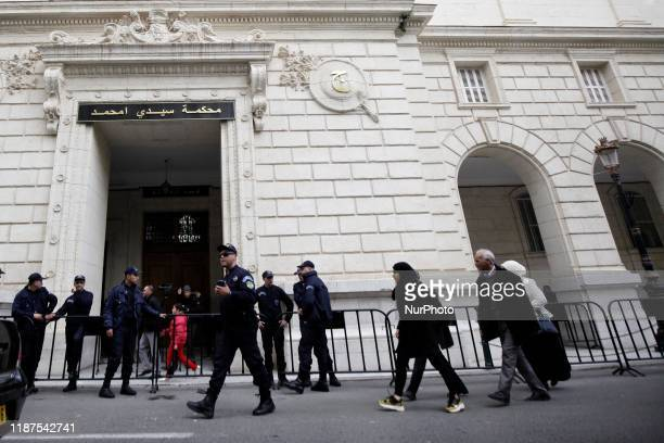 Algerian security forces gather outside the Sidi Mhamed court in the capital Algiers on December 10 during the corruption trial of former political...