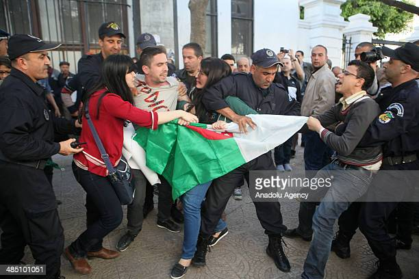 Algerian security forces interfere to demonstrators as a group of Algerian people protest against Algerian President Abdelaziz Bouteflika in Algiers...