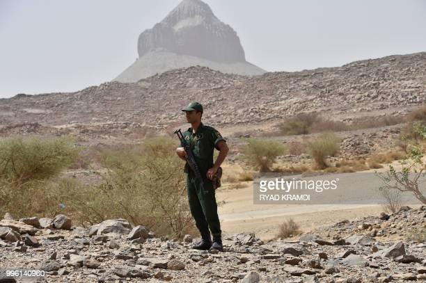 Algerian security members patrol in Tamanrasset desert000 kms south of Algiers on July 2 2018