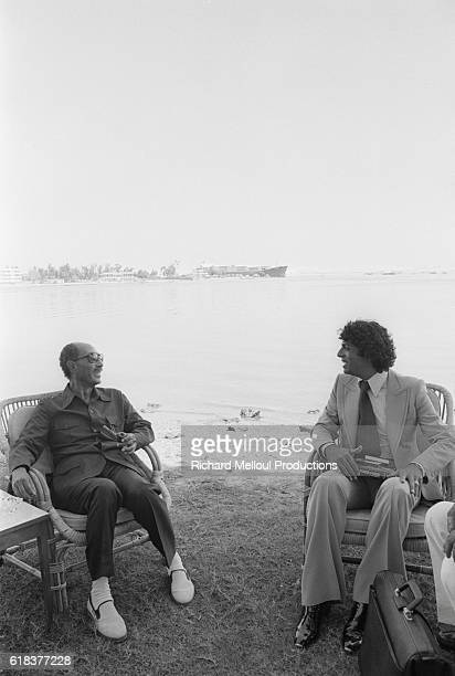 Algerian singer Enrico Macias talks with Egyptian President Anwar Sadat at his private residence Macias was invited by President Sadat to perform in...