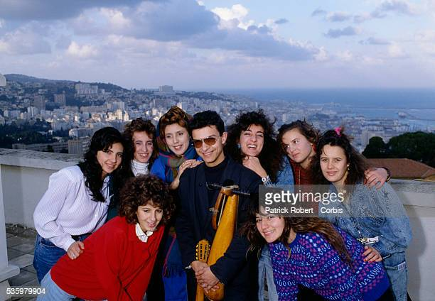 Algerian singer Hamidou poses with a group of young women in Algiers