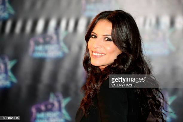 Algerian singer Zaho poses on the red carpet upon her arrival to the 18th Annual NRJ Music Awards on November 12 2016 at the Palais des Festivals in...