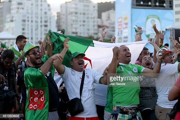 Algerian soccer fans react as their team scores a goal against South Korea as they watch on a screen setup at the FIFA Fan Fest on Copacabana beach...