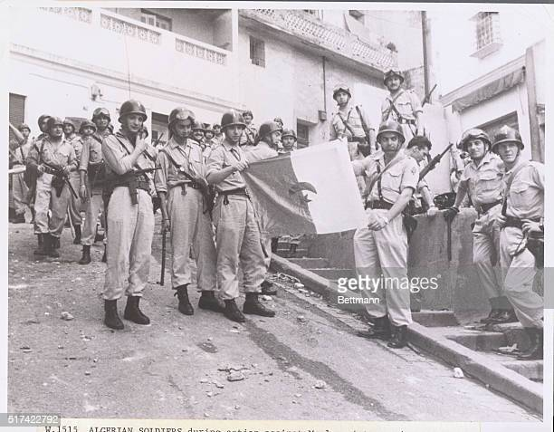 Algerian soldiers during action against Moslem rioters, who protested division of Algeria between European and Moslem sections.