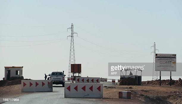 Algerian soldiers man a checkpoint near In Amenas deep in the Sahara near the Libyan border on January 19 2013 Islamist gunmen killed seven foreign...