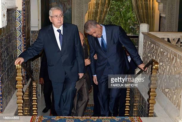 Algerian Speaker of the Council of the Nation Abdelkader Bensalah walks up the stairs as President of the National People's Assembly MohamedLarbi...