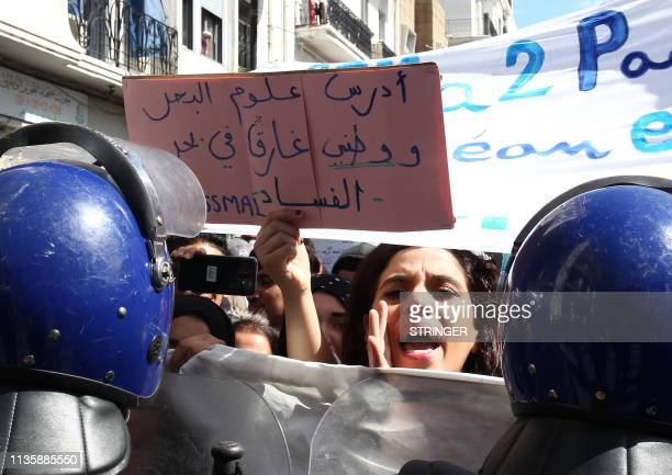 Algerian students carry placards as they take part in an antigovernment demonstration in the capital Algiers on April 9 2019 The placard reads in...
