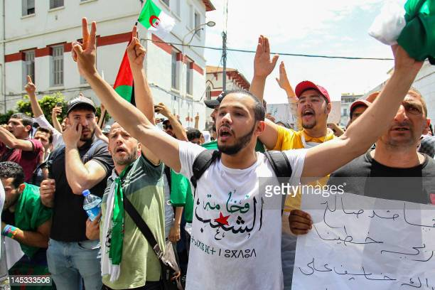 Algerian students chant slogans as they take part in a demonstration in the capital Algiers on May 21 2019 Algeria's army chief urged demonstrators...