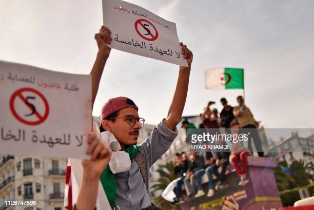 Algerian students hold up banners as they demonstrate in the capital Algiers on March 5 2019 against their ailing president's bid for a fifth term...