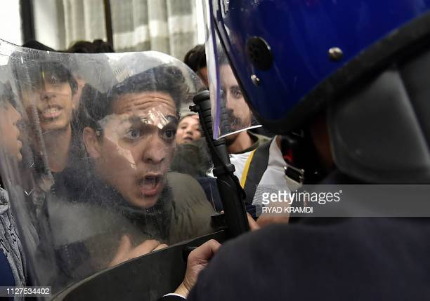 Algerian students scuffle with security forces during a protest in the capital Algiers against ailing President Abdelaziz Bouteflika's bid for a...