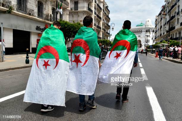 TOPSHOT Algerian students take part in a demonstration to mark the 63rd anniversary of National Student Day in the capital Algiers on May 19 2019