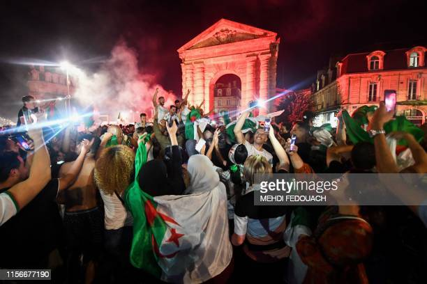Algerian supporters celebrate on Place de la Victoire square in Bordeaux, southwestern France, after Algeria won 1-0 the 2019 Africa Cup of Nations...