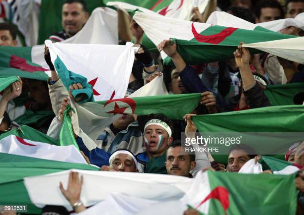 Algerian supporters cheer on their team during their match against Egypt at the African Nations Cup in Sousse 29 January 2004 Algeria won 21 AFP...