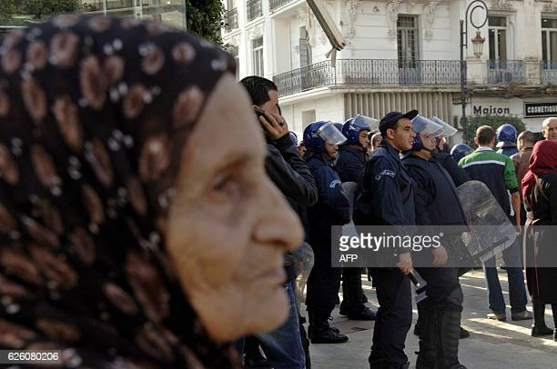 Algerian trade unionists gather outside the People's National Assembly bulding in the capital Algiers on November 27 to portest the pension reform...