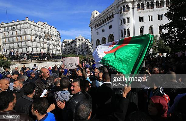 Algerian trade unionists shouts slogans as they gather outside the People's National Assembly bulding in the capital Algiers on November 27 to...