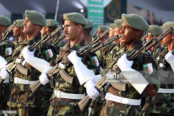 Algerian troops march during a military parade in Tripoli on September 1 2009 to mark the 40th anniversary since Kadhafi seized power in the north...
