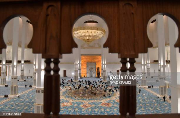 Algerian worshippers pray on October 28, 2020 at the Great Mosque of Algiers, also known as Djamaa el-Djazair, during its inauguration in the...