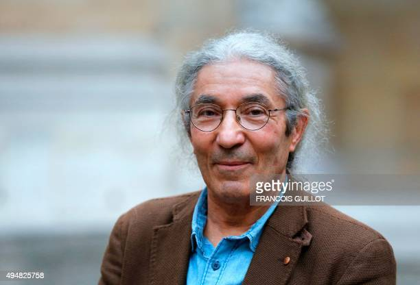 Algerian writer Boualem Sansal poses after being awarded jointly with French writer Hedi Kaddour the Grand Prix du Roman a literary prize awarded by...