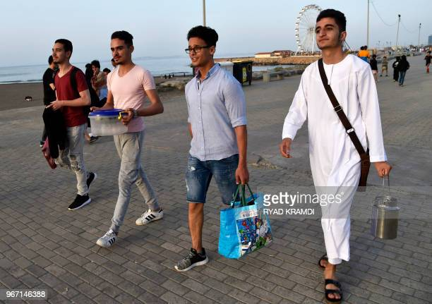 Algerian youth arrive to break their fast on the Sablettes beach seafront promenade five kilometres East of Algiers' city centre on May 25 2018 More...