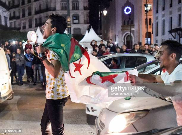 Algerian youths march with national flags during a demonstration in the centre of the capital Algiers on March 11 after President Abdelaziz...