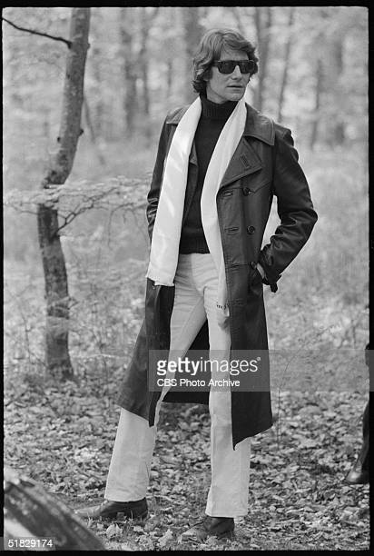 Algerian-born fashion designer Yves Saint Laurent poses outdoors in a leather trenchcoat and sunglasses in the CBS special 'The Paris Collections...