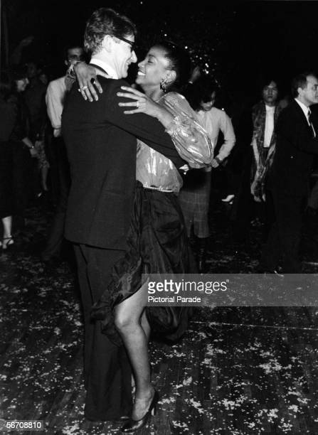 Algerianborn French fashion designer Yves St Laurent dances with American soul singer Diana Ross at a fundraiser for UNICEF at Club 78 Paris France...