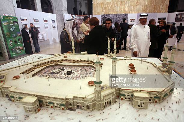 Algerians and Saudis stand next a huge model of the holy site of Kaaba in Saudi Arabia during the inaugural ceremony of the Saudi Arabia 'Culture...