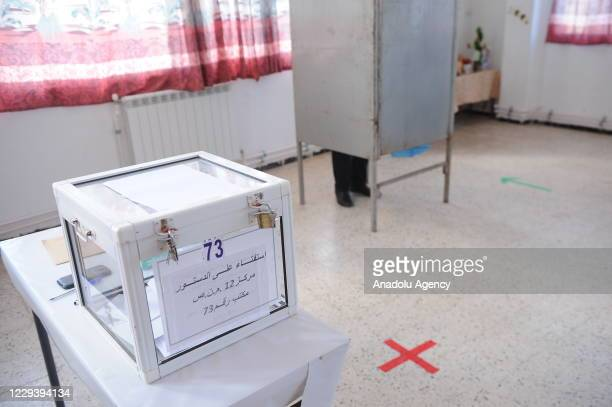 Algerians arrive at polling station, under the novel coronavirus measures, for cast their ballot in a referendum on constitutional amendments, on...