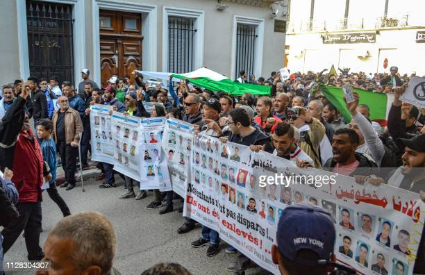 Algerians chant slogans and wave national flags as they march during a protest rally against ailing President Abdelaziz Bouteflika's bid for a fifth...