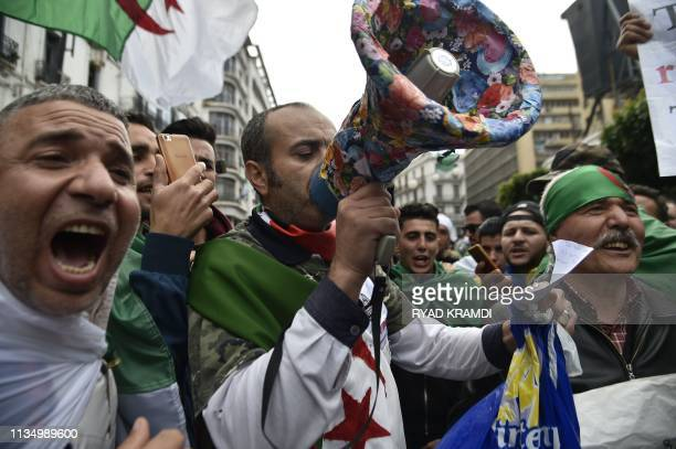 Algerians chant slogans as they take part in an antigovernment demonstration on April 5 2019 in the capital Algiers Algerians were gathered today for...