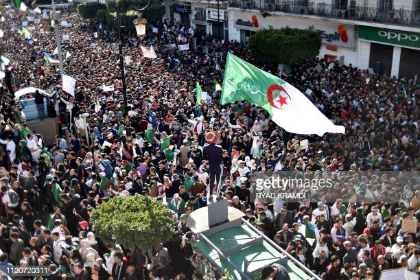TOPSHOT Algerians demonstrate during the first Friday rally since the president's surprise announcement this week that he would not seek reelection...