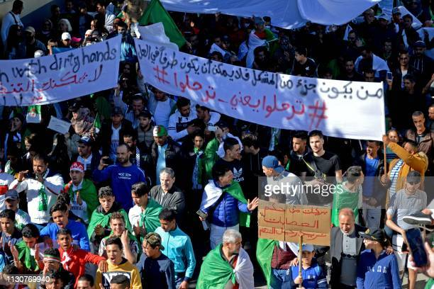 Algerians demonstrate during the first Friday rally since the president's surprise announcement this week that he would not seek reelection but was...