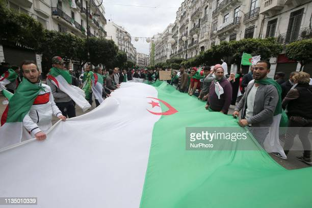 Algerians gather during an antigovernment demonstration in the capital Algiers on April 5 2019 Algerians were gathered today for the first mass...