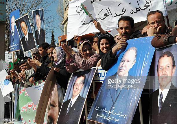 Algerians in support of President Abdelaziz Bouteflika celebrate during an election campaign rally in Batna some 450 km east of Algiers on March 19...