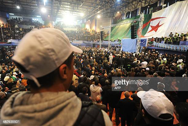 Algerians listen to presidential candidate Ali Benflis delivering a speech during his campaigning in the northern city of Batna on April 5 2014...